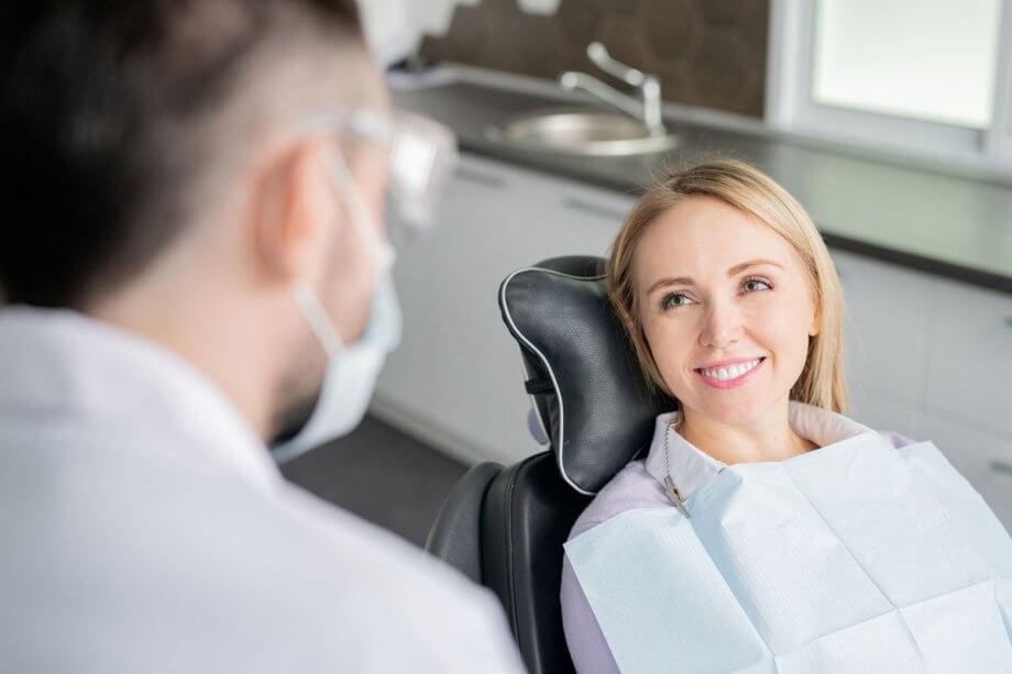 female dental patient smiling at dentist